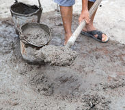 Worker stirs concrete shovel Royalty Free Stock Photos
