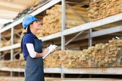 Worker stock taking warehouse Royalty Free Stock Photos