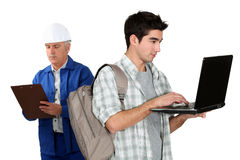 Worker stood with teenager Stock Photo