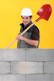 Worker stood by wall Stock Images