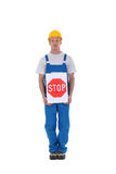 Worker with a stop sign Royalty Free Stock Photos