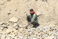 Worker on the street in Leh. Ladakh province. Royalty Free Stock Image
