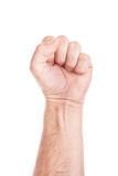 Worker on strike. Labor movement, workers union strike concept with male fist isolated on white background raised in the air fighting for their rights Royalty Free Stock Image