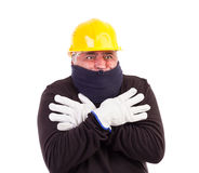 Worker suffering cold with arms crossed Stock Images