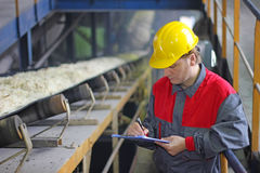 Worker in sugar refinery Stock Photos