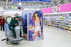 Worker in supermarket Stock Image