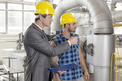 Worker with supervisor inspecting industrial area Royalty Free Stock Photography