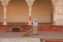 Worker sweeping in Anguri Bagh Grape Garden in Agra Fort, Utta Stock Photography