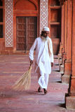 Worker sweeping courtyard of Jama Masjid in Fatehpur Sikri, Utta. R Pradesh, India. The mosque was built in 1648 by Emperor Shah Jahan and dedicated to his Stock Images