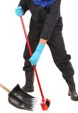 Worker sweeping floor. Royalty Free Stock Photos