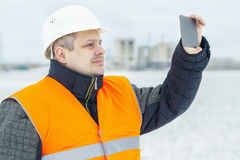 Worker with tablet PC on the field in winter Stock Photo
