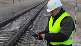 Worker with tablet PC near railway stock video