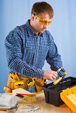 Worker takes carpenter vise Royalty Free Stock Photography