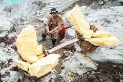 Worker takes a rest at Ijen crater, Java, Indonesia Royalty Free Stock Image