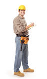 Worker taking notes. Cheerful contractor taking notes while looking at camera Stock Photo