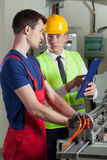 Worker talking with boss Stock Images