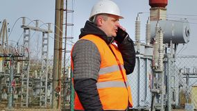 Worker talking on cell phone at power plant stock footage