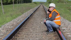 Worker talking on cell phone on the railway stock video