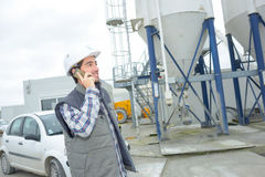 Worker talking on cellular. Worker talking on the his cellular Royalty Free Stock Photo