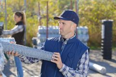 Worker talking metal fence Royalty Free Stock Photography