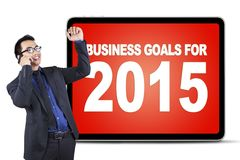 Worker talking on the phone with business goals Stock Images