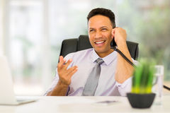 Worker talking on telephone. Handsome office worker talking on telephone Royalty Free Stock Image
