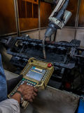 The Worker Teaching Program Robot Stock Photo