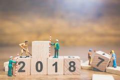 Worker team building wooden block number 2018 Stock Photography
