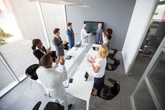 Worker team clapping hands in office Royalty Free Stock Photos