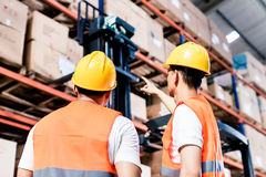 Worker team taking inventory in warehouse Royalty Free Stock Image