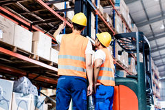 Worker team taking in logistics warehouse Stock Photo