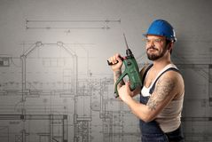 Worker with technical drawing. Stock Photos