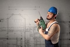 Worker with technical drawing. Stock Images