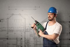 Worker with technical drawing. Royalty Free Stock Images