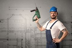 Worker with technical drawing. Royalty Free Stock Photography
