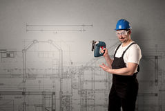 Worker with technical drawing. Royalty Free Stock Photos