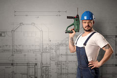 Worker with technical drawing. Royalty Free Stock Image