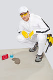 Worker test humidity of concrete with water Royalty Free Stock Photo