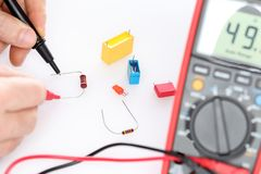 Worker is testing a resistor royalty free stock photos