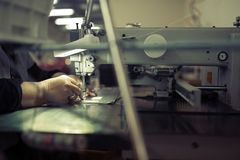 Worker in textile industry sewing royalty free stock photos