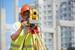 Worker with theodolite Stock Photos