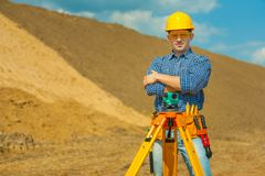 Worker with theodolite on construction site Stock Images