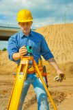 A worker with theodolite Royalty Free Stock Photos