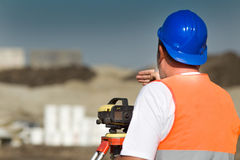 Worker with theodolite Royalty Free Stock Image