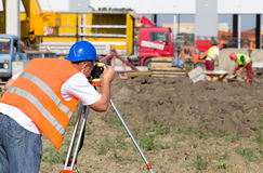 Worker with theodolite Stock Image