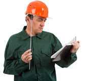 Worker thinking after looking at your notes Stock Image