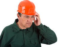 Worker thinking after looking at your notes Royalty Free Stock Image