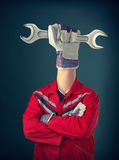 Worker with third hand Royalty Free Stock Photography