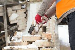 Worker throws bricks Stock Photos