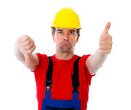 Worker with thumb up and down Royalty Free Stock Photo